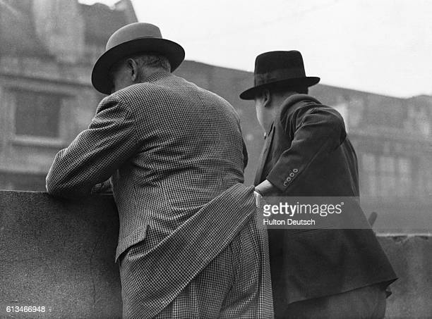 A mockup scene of a pickpocket in action circa 1930's