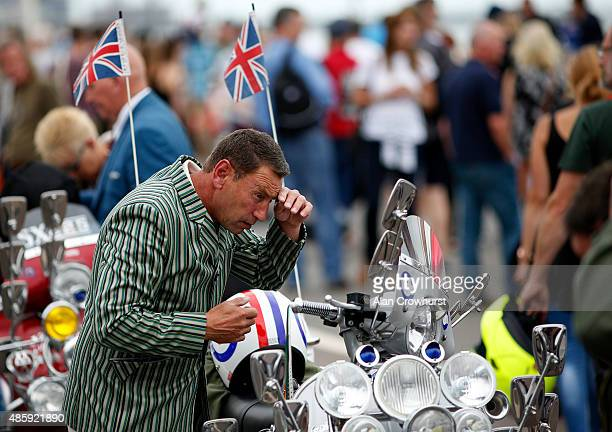 A mod checks his apperance in his mirrors during the Brighton Mod Weekender where mods and their scooters gather on the annual bank holiday weekend...