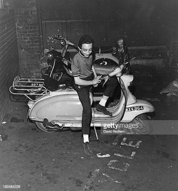 A mod posing on his scooter outside The Scene club in Soho London circa 1964