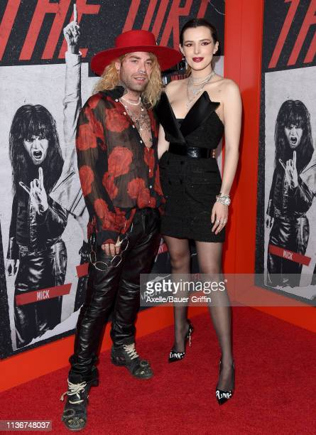 Mod Sun and Bella Thorne arrive at the premiere of Netflix's 'The Dirt' at ArcLight Hollywood on March 18 2019 in Hollywood California
