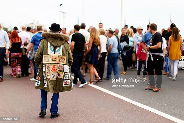 A mod takes a stroll on the promenade during the Brighton Mod Weekender where mods and their scooters gather on the annual bank holiday weekend event...