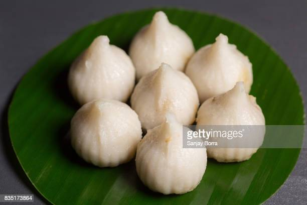 modak on a banana leaf - ganesh chaturthi stock photos and pictures