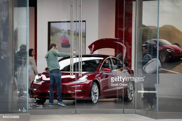 Model 3 sits on the showroom floor at a Tesla dealership on March 30 2018 in Chicago Illinois Tesla has announced it is recalling 123000 of its Model...