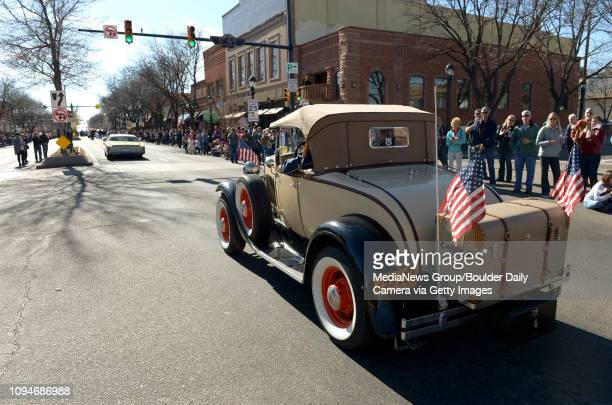 Model A Ford makes its way south on Main Street during Longmont's annual Veterans Day parade Friday Spectators and participants were greeted with...