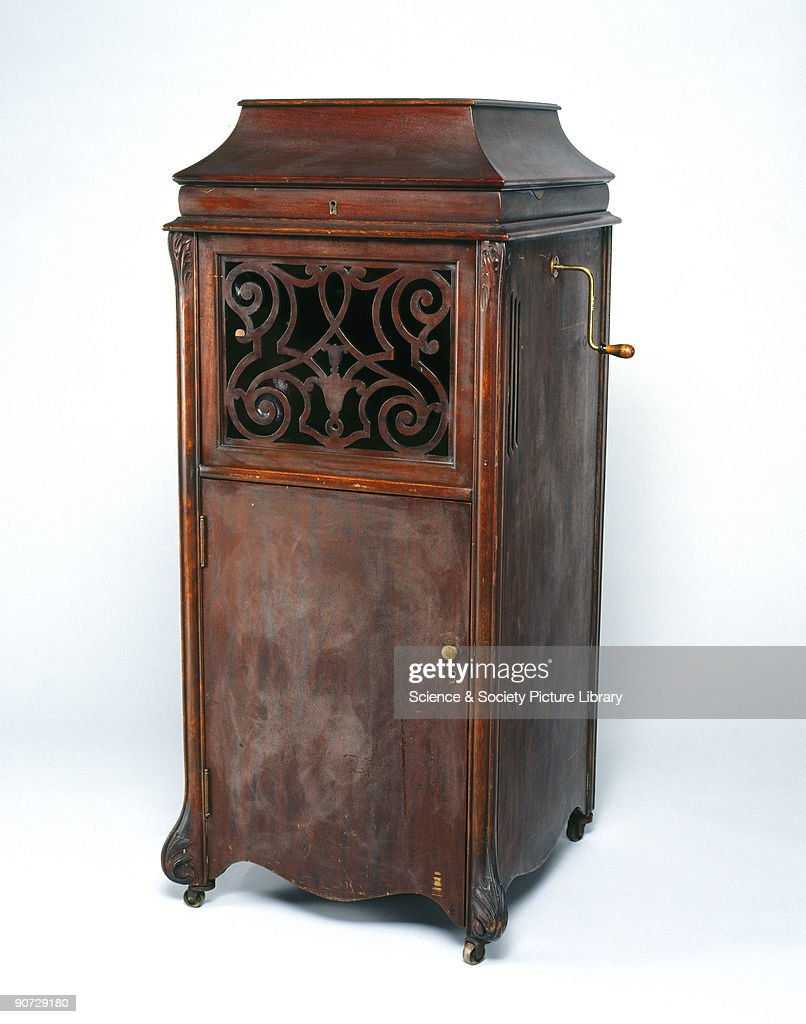 Model A Phonograph, Contained In An Upright Floor Standing Cabinet. It Has  Four