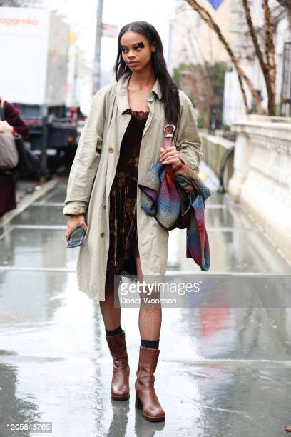 Model Aaliyah Hydes is seen wearing a dark brown Beverly Johnson dress with brown boots and light green Burberry jacket outside of the Vera Wang show...