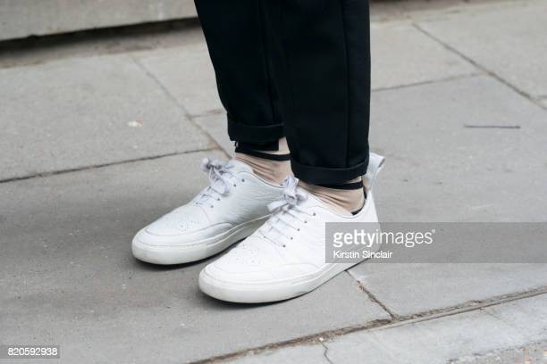 Model Aaron Lesta wears Blood Brothers trainers Axel Arigato trousers and KTZ socks on day 3 of London Collections Men on June 11 2017 in Paris France