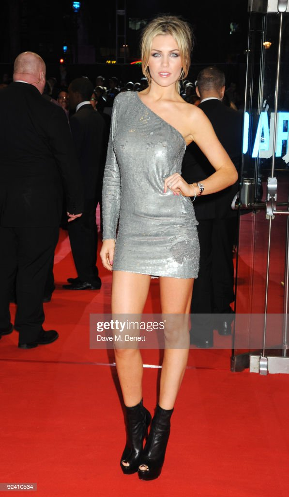 Model Abbey Clancy arrives at the UK film premiere of 'This Is It', at the Odeon Leicester Square on October 27, 2009 in London, England.