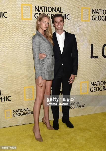 Model Abby Champion and actor Patrick Schwarzenegger arrive at the premiere of National Geographic's 'The Long Road Home' at Royce Hall on October 30...