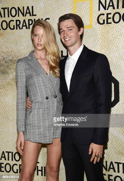 Model Abby Champion and actor Patrick Schwarzenegger arrive at the premiere of National Geographic's The Long Road Home at Royce Hall on October 30...