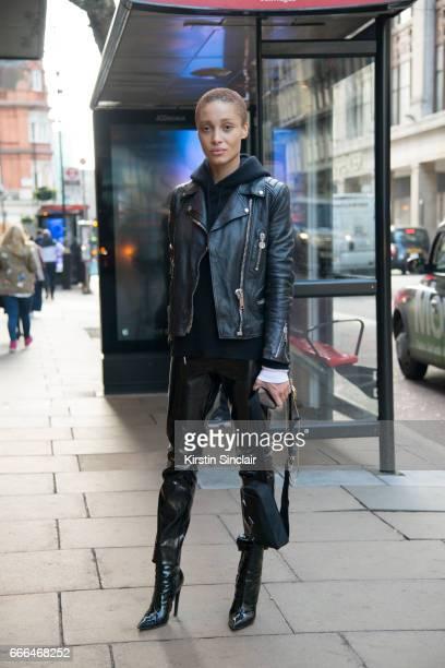 Model Aboah Adwoa wears a Mulberry jacket Alexander Wang sweater Balenciaga boots and a Prada bag on day 4 of London Womens Fashion Week...