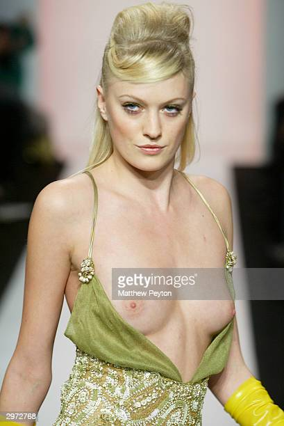 A model accidentally exposes her breast on the runway at the Jennifer Nicholson Fall 2004 Fashion show during Olympus Fashion Week at the Atelier in...