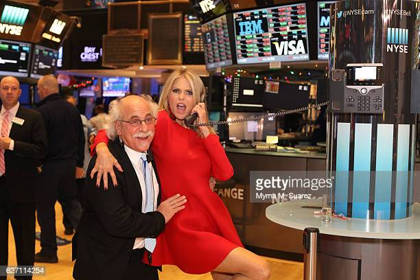 Model actress and entrepreneur Christie Brinkley poses with her trader Peter Tuchman after ringing the closing bell for the launch of her new...