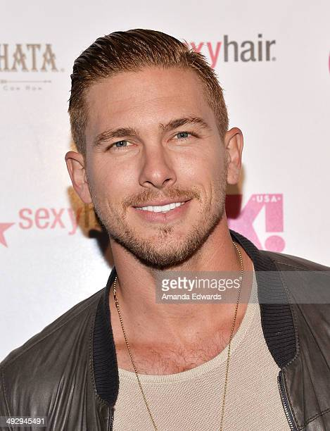 Model Adam Senn arrives at OK Magazine's 'So Sexy' LA Event at Lure on May 21 2014 in Hollywood California