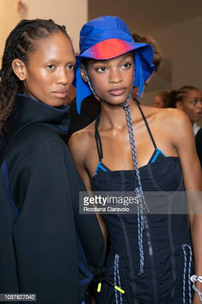 Model Adesuwa Aighewi and Theresa Hayes are seen backstage ahead of the Sportmax show during Milan Fashion Week Spring/Summer 2019 on September 21...