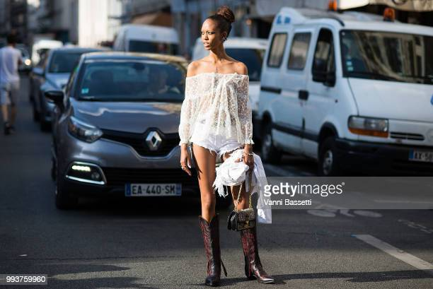 Model Adesuwa Aighewi guest poses after the Fendi Couture show at the Palais Brongniart during Paris Fashion Week Haute Couture FW18 on July 4 2018...