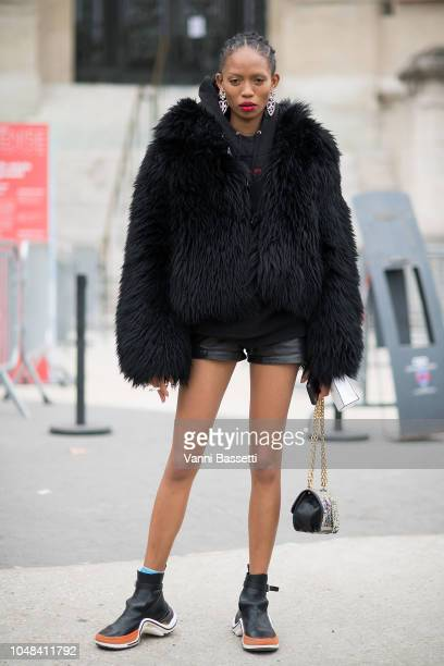 Model Adesuwa Aighewi poses after the Chanel show at the Grand Palais during Paris Fashion Week SS19 Womenswear on October 2 2018 in Paris France