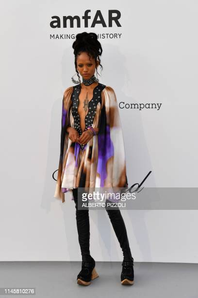US model Adesuwa Aighewi poses as she arrives on May 23 2019 at the amfAR 26th Annual Cinema Against AIDS gala at the Hotel du CapEdenRoc in Cap...