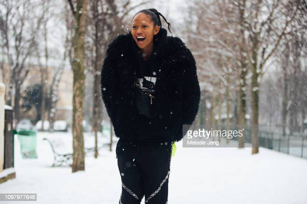 Model Adesuwa Aighewi poses ini the snow after the Chanel show during Couture Fashion Week Spring/Summer 2019 on January 22 2019 in Paris France