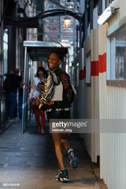 Model Adesuwa Aighewi runs to her next show during Couture Fall 2018 Fashion Week on July 2 2018 in Paris France