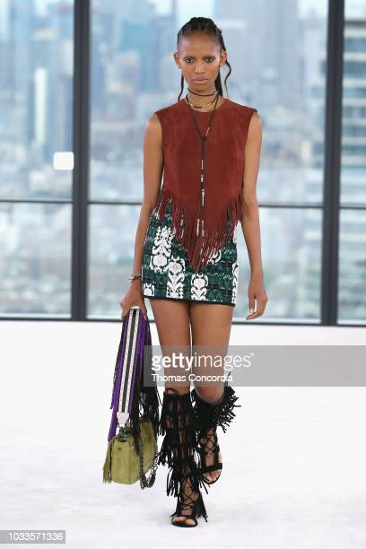Model Adesuwa Aighewi walks the runway look during the Longchamp Spring 2019 Runway Show on September 8 2018 in New York City