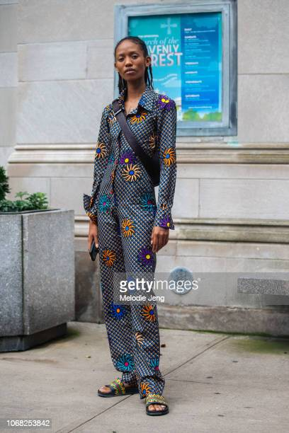 Model Adesuwa Aighewi wears a Nigerian print jumpsuit and slide sandals after the Tory Burch show during New York Fashion Week Spring/Summer 2019 on...