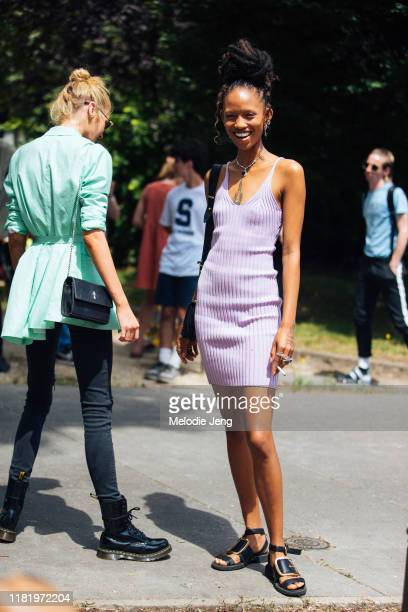 Model Adesuwa Aighewi wears a purple knit sleeveless dress and black buckle sandals after the Redemption show during Couture Fashion Week Fall/Winter...