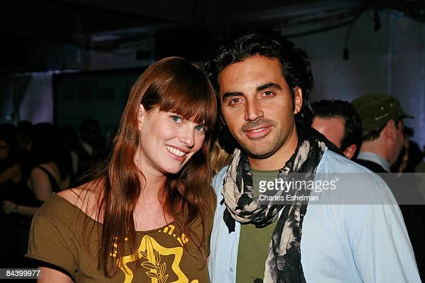 Model Adi Neumann and fashion designer Yigal Azrouel attend the benefit for victims of terror and a solidarity event for Israel at Ground Zero on...