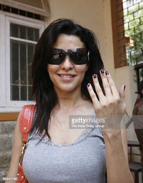 Model Aditi Govitrikar shows her hand after casting her vote on April 30 2009 in Mumbai India India is the world's largest democracy and voting is...