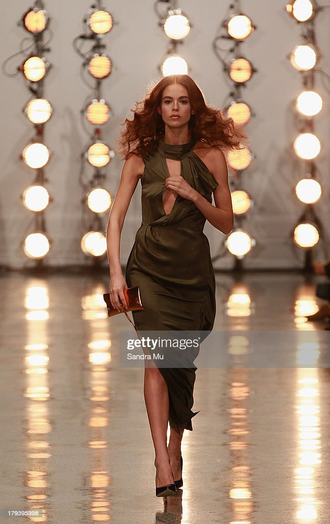 A model adjusts her dress by Hailwood on the runway during New Zealand Fashion Week at the Viaduct Events Centre on September 3, 2013 in Auckland, New Zealand.