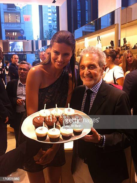 Model Adriana Lima and designer Vince Camuto pose at the Vince Camuto Flagship Opening in collaboration with New Yorkers for Children at the Vince...