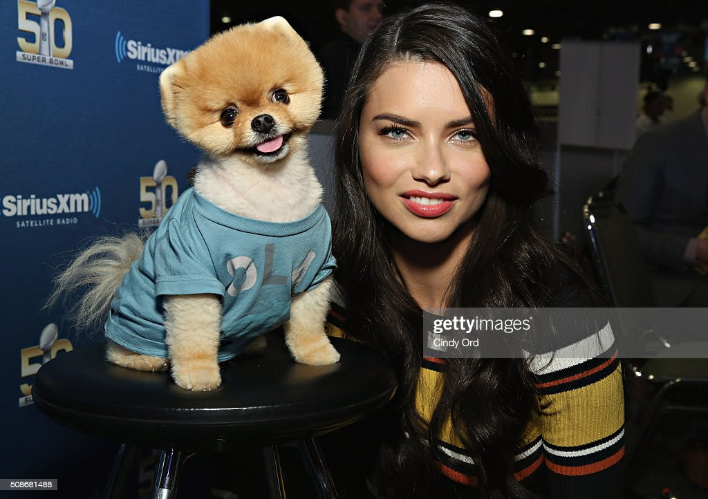 Model Adriana Lima and Jiffpom visit the SiriusXM set at Super Bowl 50 Radio Row at the Moscone Center on February 5, 2016 in San Francisco, California.