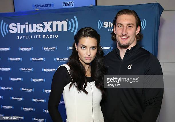 Model Adriana Lima and Ohio State University defensive player Joey Bosa visit the SiriusXM set at Super Bowl 50 Radio Row at the Moscone Center on...