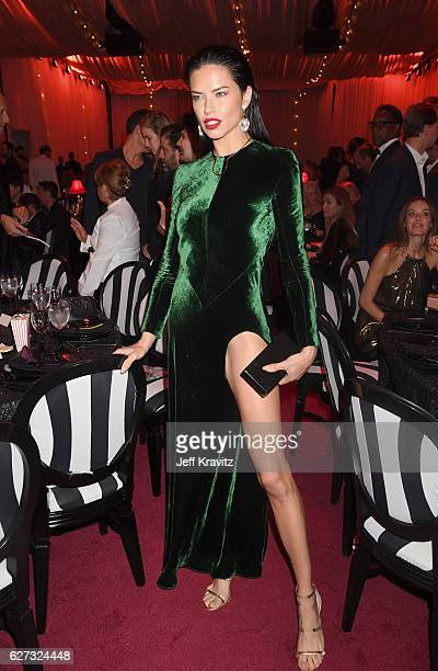 Model Adriana Lima attends Madonna presents An Evening of Music Art Mischief and Performance to benefit Raising Malawi at Faena Forum on December 2...
