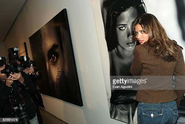 Model Adriana Lima attends the Victoria's Secret 'Sexy Volume 3 A Tribute to a Decade of Sexy Swimwear' photo exhibit and book launch event at Milk...