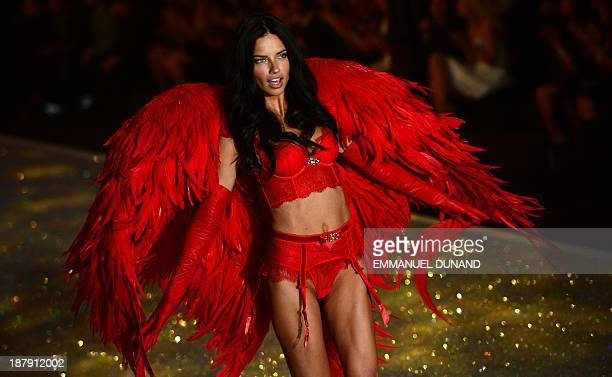 Model Adriana Lima performs during the 2013 Victoria's Secret Fashion Show at the Lexington Avenue Armory on November 13, 2013 in New York. AFP...