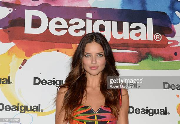 Model Adriana Lima poses during a photocall for Desigual's SpringSummer 2014 Collection 'For Everybody Sex Fun Love' during 080 Barcelona Fashion...