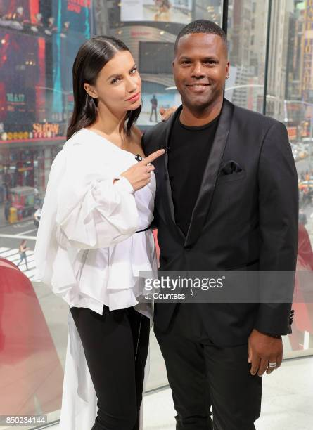 Model Adriana Lima poses for a photo with A J Calloway during her visit to 'Extra' at their New York Studios at HM Times Square on September 20 2017...