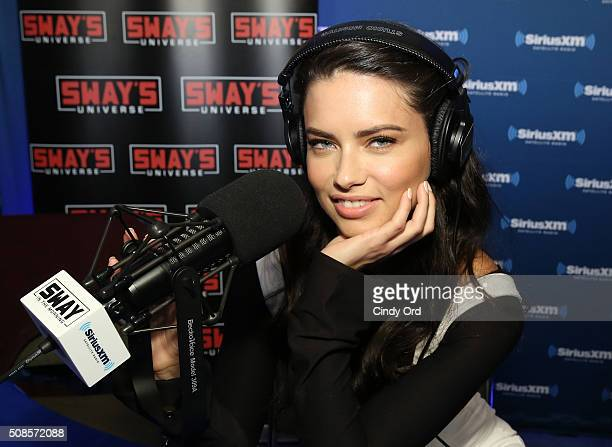 Model Adriana Lima visits the Sway's Universe SiriusXM set at Super Bowl 50 Radio Row at the Moscone Center on February 5 2016 in San Francisco...