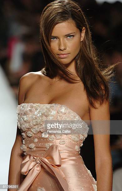 Model Adriana Lima walks down the runway at the Luca Luca Couture Spring 2005 fashion show during the Olympus Fashion Week Spring 2005 at the Theater...