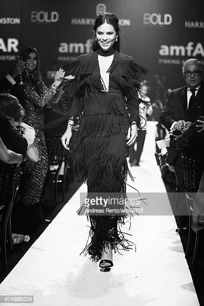 Model Adriana Lima walks the runway at amfAR's 22nd Cinema Against AIDS Gala Presented By Bold Films And Harry Winston at Hotel du CapEdenRoc on May...