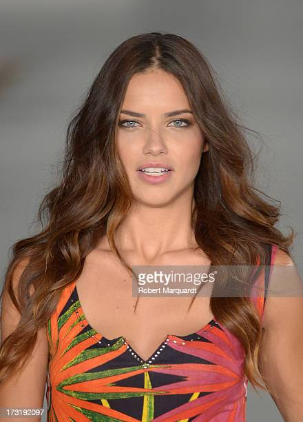 Model Adriana Lima walks the runway at Desigual's SpringSummer 2014 Collection 'For Everybody Sex Fun Love' during 080 Barcelona Fashion Week on July...
