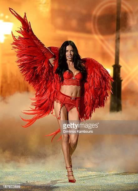 Model Adriana Lima walks the runway at the 2013 Victoria's Secret Fashion Show at Lexington Avenue Armory on November 13, 2013 in New York City.