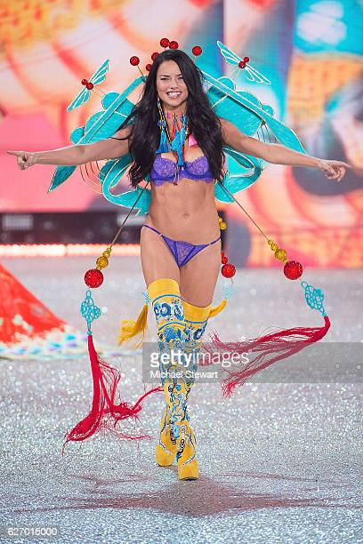 Model Adriana Lima walks the runway during the 2016 Victoria's Secret Fashion Show at Le Grand Palais in Paris on November 30 2016 in Paris France
