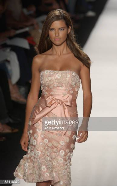 Model Adriana Lima wearing Luca Luca Spring 2005 during Olympus Fashion Week Spring 2005 Luca Luca Runway at Theater Tent Bryant Park in New York...