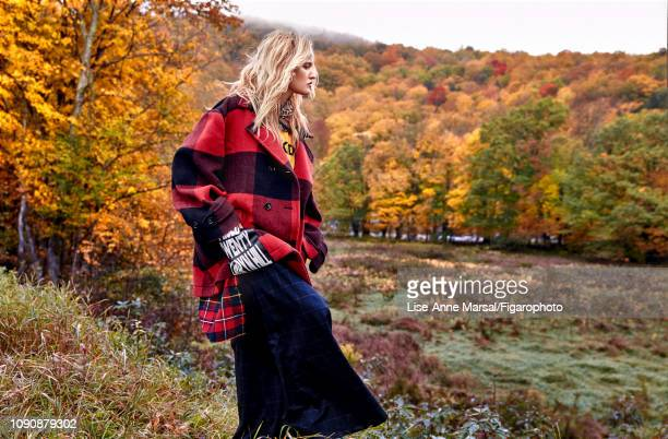 Model Adrianna Bach poses at a fashion shoot for Madame Figaro on October 8 2018 in Massachusetts Coat pants tshirt polo scarf PUBLISHED IMAGE CREDIT...