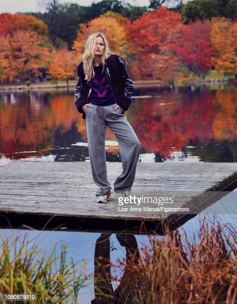 Model Adrianna Bach poses at a fashion shoot for Madame Figaro on October 8 2018 in Massachusetts Jacket pullover pants shirt sneakers PUBLISHED...