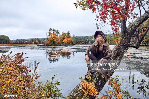 Model Adrianna Bach poses at a fashion shoot for Madame Figaro on October 8 2018 in Massachusetts Coat shirt and hat pants camisole socks shoes...