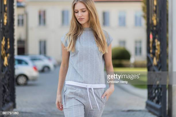 Model Adrianna Daniel wearing a grey track suit pants and sneakers Adidas Originals on March 31 2017 in Warsaw Poland