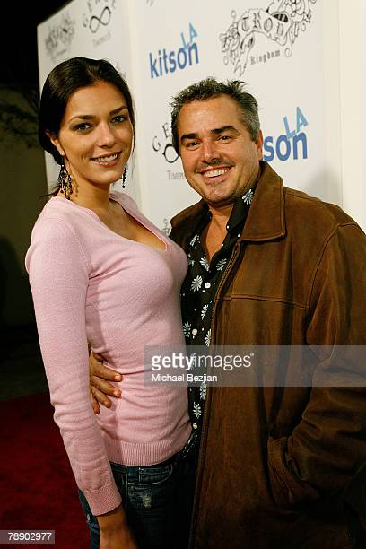 Model Adrianne Curry and actor Christopher Knight arrive at the Catwalk for Kitson / Troy Kingdom Show at Boulevard 3 on January 10 2008 in Los...